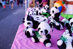 Little pandas at night market Royalty Free Stock Images