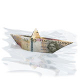 Little paper boat with 50 Swedish Crowns. On the water Royalty Free Stock Images