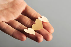 Little paper cutout hearts on hand Stock Photos