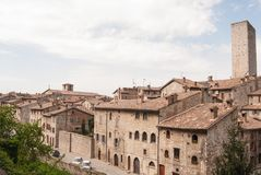Gabrielli tower with some typical houses. Little part of medieval city of Gubbio with his storical stone constructions Royalty Free Stock Image
