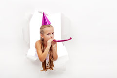 Little party girl with hat and whistle Royalty Free Stock Images