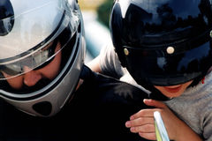 Little Passenger. Father and son getting on a motorcycle royalty free stock photography