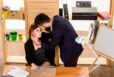 A little passion at work. Love affair of bearded man and sexy woman in office. Couple in love conducting affair at work. A little passion at work. Love affair of royalty free stock photos