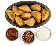 Little pasties on dish and bowls  with sauce and spices Stock Photography