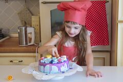 The little pastry chef finishes her cake