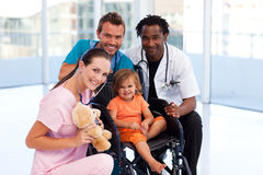 Little patient with medical team Stock Photo