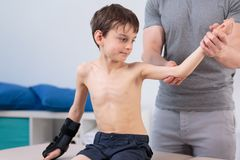Little patient on physiotherapy Stock Images