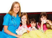 Little Patients and Their Pediatrician Stock Image