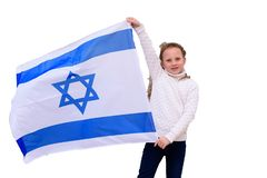 Little patriot jewish girl with flag Israel isolated on white background. Little patriot jewish girl standing  and enjoying with the flag of Israel on white stock photography