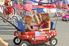 Little Patriotic Wagon. Kids get pulled in wagon during the Mueller neighborhood 4th of July parade in Austin, TX Royalty Free Stock Image
