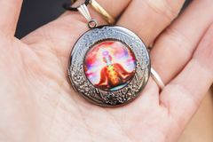 Little pendant jewellery with esoteric design. Little pendant jewellery with colorful esoteric design stock photography