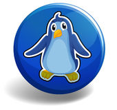 Little penguin on blue badge Stock Photo