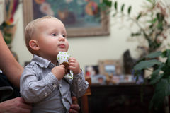 Little pensive baby boy with table napkin indoor Royalty Free Stock Photography