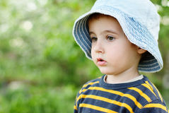 Little pensive boy in jeans hat stock image