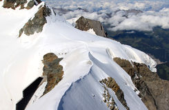 Little people upon snowy Swiss Jungfrau mountain stock photography