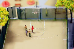 Little people toys playing basketball Royalty Free Stock Photography