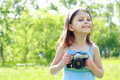 Little photographer. Little beautiful happy girl with the camera Stock Image