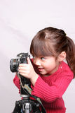 The little photographer. A young girl plays with an older camera Royalty Free Stock Photo