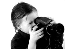Little photographer. Sweet child as a photographer royalty free stock photography