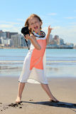 Little photographer. Cheerful little girl with digital camera at the beach Stock Images