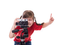Little photographer with old fashioned camera. Prepearing to take a picture Stock Photography