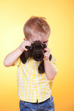 Little photographer shooting professional camera Royalty Free Stock Photography