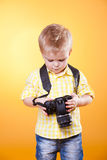 Little photographer watch photo on camera Royalty Free Stock Photos