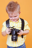Little photographer watch photo on camera Royalty Free Stock Image