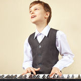 Little pianist play the keys of synthesizer Stock Photo