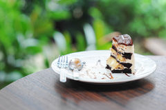 Little pice of chocolate cake with banana Stock Photos