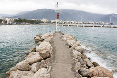 Little Pier And Lighthouse Royalty Free Stock Images