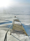 Little pier in a winter. Royalty Free Stock Images