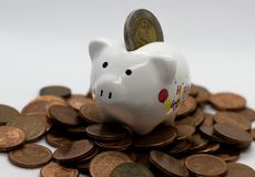 Piggy Bank, Savings, Currency. Coin. a little pig. A little pig, a piggy bank, different coins, European money. Savings deposit, savings for the future Stock Photos