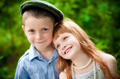Little boy and girl. Little pigeon pair at a tree Stock Photography