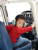 Little Pilot. Little boy with headset prepares for takeoff Royalty Free Stock Photography