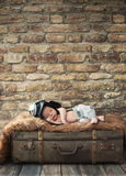 Little pilot baby sleeping on the luggage Royalty Free Stock Photo
