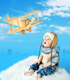 Little pilot looking at the toy airplane Stock Image