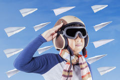 Little pilot with a saluting gesture Royalty Free Stock Photos