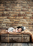 Little pilot sleeping on the suitcase Royalty Free Stock Image