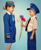Little pilot and stewardess royalty free stock image