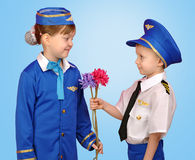 Little pilot and stewardess royalty free stock photography