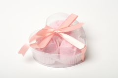 Little pink cakes in a heart shaped box over white. Background Stock Photography