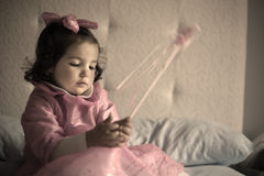 Little pink fairy with magic wand Royalty Free Stock Photography