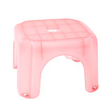 Little pink plastic stool isolated. Over white Royalty Free Stock Photo