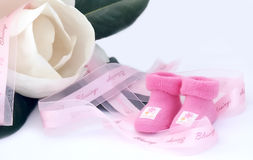 Little pink socks. Magnolia flower , pink ribbon and pink girl socks Royalty Free Stock Image