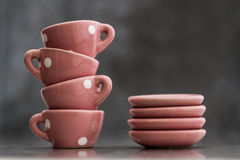 Little Pink Toy Porcelain Cups and Plates with White Dots Royalty Free Stock Photography