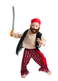 Little Pirate. Pirate child.  Young boy dressed as a pirate swinging a sword and wearing a fake beard.  Child is happy and playful, ready for a fun time on Royalty Free Stock Images