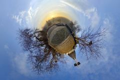 Little Planet Cluj-Napoca, Romania. Little planet (stereographic) projection of Acropolis Park (Parcul Cetățuia) at sunrise on a cloudy winter day in Cluj Royalty Free Stock Images