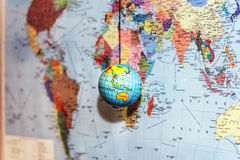 Little planet globe on world background Royalty Free Stock Photos