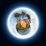 Little planet with palm trees and tropical islands Royalty Free Stock Photo